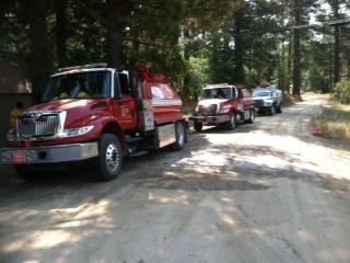 Fire trucks filling at MLIA Ole water tank Jul 9.