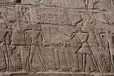 Rameses II (right) dedicating a temple to his god, Amun-Ra