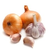 two onions and a garlic on a white background closeup