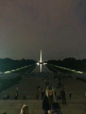 Washington Memorial lit up at night, viewed from the steps of the Lincoln Memorial