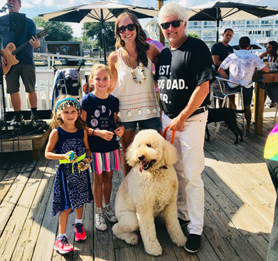 ABC News 4's Erin Kienzle and her daughters pose for a photo with Charlie Macchio and his human Bill Macchio at the look-alike contest