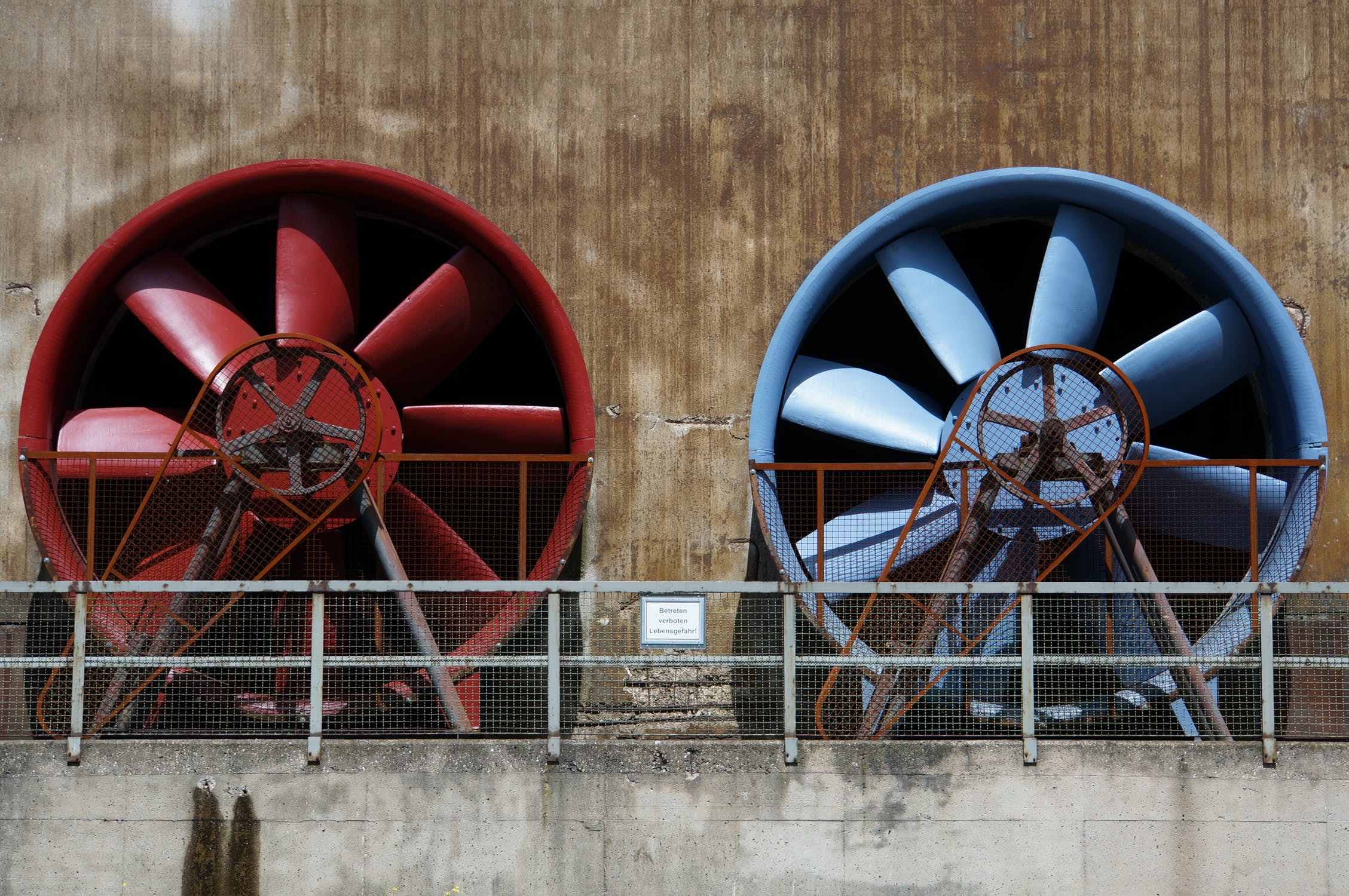 two very large industrial fans outdoors
