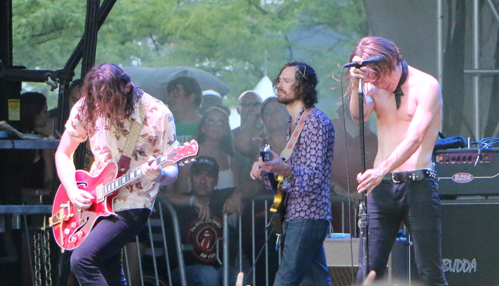 Nick Bockrath, left, Matthan Minster, center, and Matt Shultz, right, of Cage the Elephant perform at the Forecastle Festival in Louisville, Ky., on Friday, July 17, 2015. (MTSU Sidelines / John Connor Coulston)