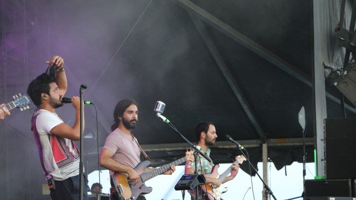 Sameer Gadhia, left, Payam Doostzadeh, center, and Eric Cannata, right, of Young the Giant perform at the Sloss Music & Arts Festival in Birmingham, Ala., on Saturday, July 18, 2015. (MTSU Sidelines / John Connor Coulston)