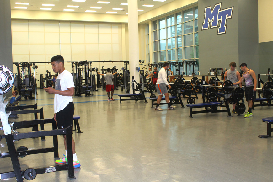 Students work out in the weight room of the Recreation Center in between classes (MTSU Sidelines/ Emily Austin)