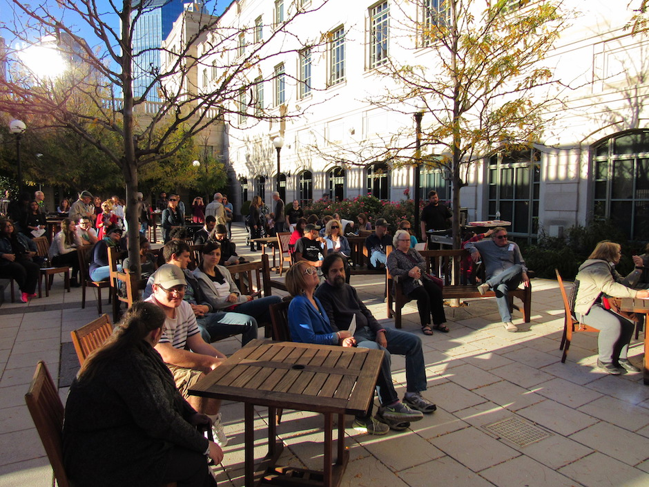People gather in front of the courtyard stage outside the Schermerhorn Symphony Center in Nashville, Tenn. on Saturday, Oct. 22.