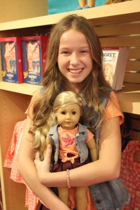 Life-sized Tenney Jenna Josten poses with the doll. (Sidelines / Tayhlor Stephenson)