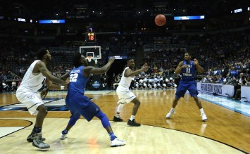 Ed Simpson sends a pass into forward JaCorey Williams in an NCAA Tournament second-round game against Butler in Milwaukee, WI on March 19, 2017. (MTSU Sidelines/Tyler Lamb)