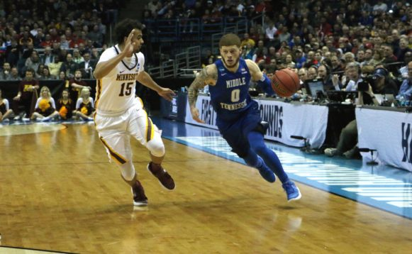 Tyrik Dixon (0) drives on Stephon Sharp (15) in an NCAA Tournament first-round game against Minnesota in Milwaukee, WI on March 16, 2017. (MTSU Sidelines/Tyler Lamb)