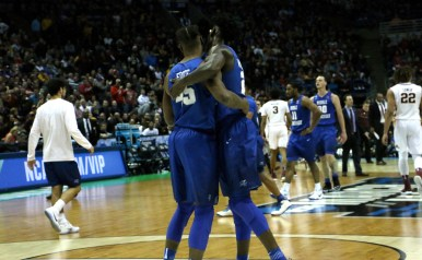 MTSU seniors Aldonis Foote and JaCorey Williams embrace towards the end of an NCAA Tournament first-round game against Minnesota in Milwaukee, WI on March 16, 2017. (MTSU Sidelines/Tyler Lamb)