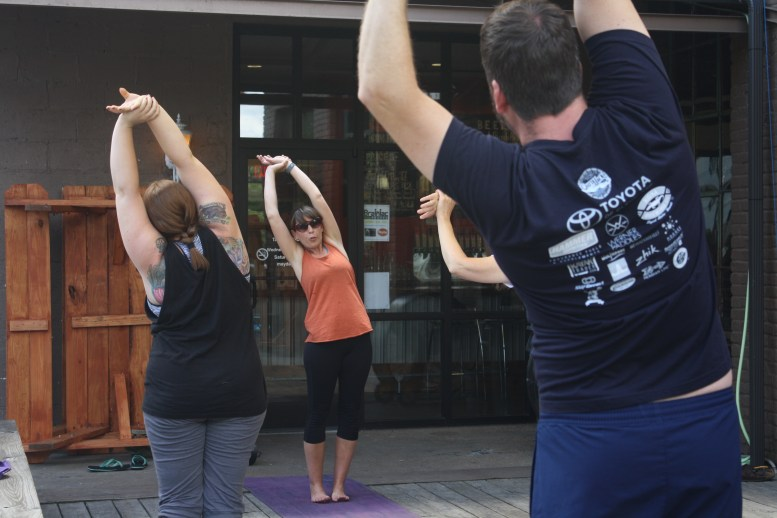 Sarah Kurtz teaching at Mayday Brewery's yoga session on Saturday, May 25, 2017. (Wesley McIntyre / Sidelines)