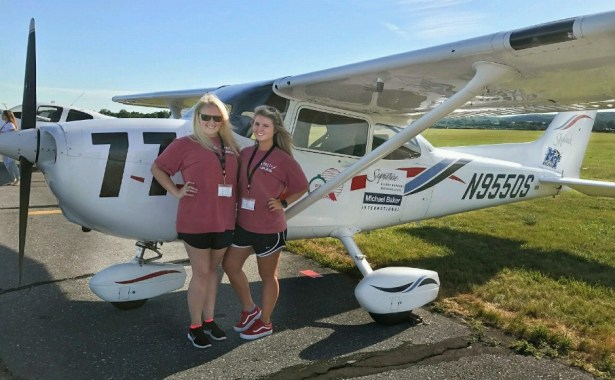 Cantrell (left) and Lindskoug (right) pose with their plane before taking it up to compete. (Submitted: Gabriella Lindskoug)