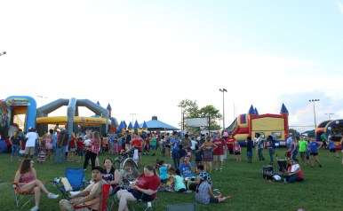 "Visitors of the ""Celebration Under the Stars"" enjoy evening festivities, including inflatables, food trucks and vendor booths at McKnight Park in Murfreesboro, Tenn. on July 4, 2017. (Connor Burnard / MTSU Sidelines)"