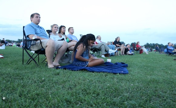 Dray Curtis (left), Addison Sloan, Whitney Ingle, Jon-Thomas Neely and Alexis Wynn (front) watch the Murfreesboro Symphony Orchestra Choir perform at McKnight Park in Murfreesboro, Tenn. on July 4, 2017. (Connor Burnard / MTSU Sidelines)