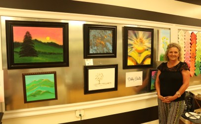 Debby Schultz exhibits her art at the Boro Art Crawl in Murfreesboro, Tenn. on August 11, 2017. (Connor Burnard / MTSU Sidelines)