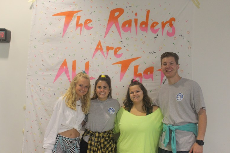 From left to right: Sophomore video and film major Margaret Mahaffey, sophomore PR major Katelyn Brosche, freshman construction management major Victoria O'Neill and senior organizational communication Peyton Tracy stop at the photo booth for a picture at Skate Back to the '90s on October 2, 2017. (Shade Narramore / MTSU Sidelines)