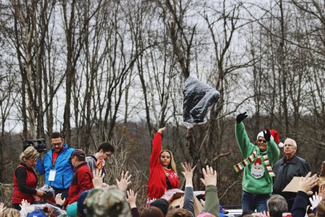 Santa Train workers toss jackets and gifts to the crowd in Dungannon, Virginia, on Nov. 18, 2017. (Anthony Merriweather / MTSU Sidelines)