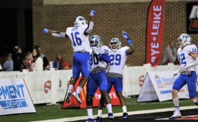 Randolph, Harris, junior Khalil Brooks and freshman Reed Blankenship celebrate Harris' touchdown against Western Kentucky in Bowling Green, Ky. on Nov. 17, 2017. (Devin P. Grimes / MTSU Sidelines)
