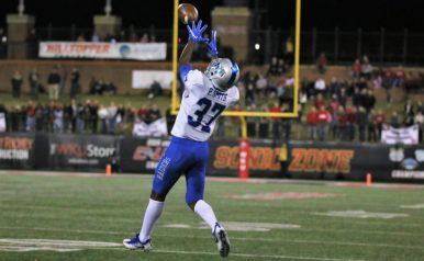 Senior Patrick Smith leaps to make a play on the ball against Western Kentucky in Bowling Green, Ky. on Nov. 17, 2017. (Devin P. Grimes / MTSU Sidelines)