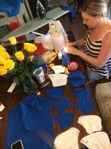 Neighbor, Carolina Forni making PPE for first responders