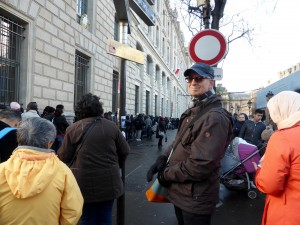 Hugh standing in front of the Prefecture de Police, Paris