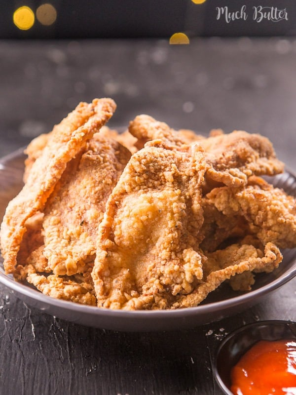 Crispy chicken skin with creamy cheese sauce is a delicious crispy snack and appetizer. It can be serve for side dish, put in on warm rice you will be have a quick meal.