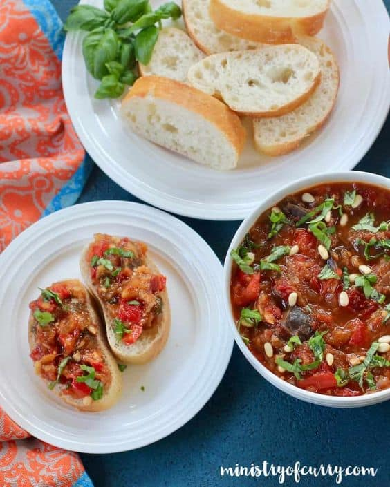 Eggplant and red pepper spread is a piquant ratatouille of soft-cooked eggplant, red peppers, and tomatoes with a perfect balance of spicy-tangy flavors and a hint of sweetness.