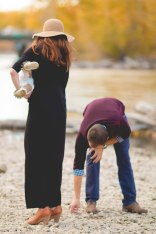 This is our normal! Nursing a fussy, tired baby while dad goofs off and tries to skip rocks!