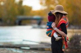 Baby wearing fall photoshoot in Idaho wearing a DIDYMOS Baby Wrap Sling Katja