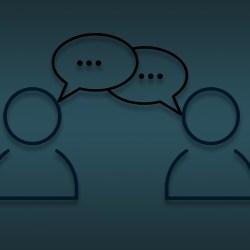 Zwei Männchen sprechen miteinander