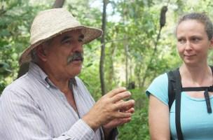 """Casa Del Sol's agro-ecologist, Juan Arriaga Mora, explains the importance of preserving the environment for future generations. """"We're leaving behind a world for you that's dirty. I'm sorry for the world we're leaving you. But you are seeds of hope that the world can be transformed,"""" Arriaga said. Photo by Jalyn Henderson El Aprendiz de Agricultura de Casa Del Sol, Juan Arriaga Moro, explica la importancia de preservar el medio ambiente para las generaciones futuras. """"Estamos dejando atrás un mundo que está sucio. Lo siento por el mundo que te dejamos. Pero son semillas de esperanza de que el mundo pueda transformarse"""" dijo Arriaga. Foto de Jalyn Henderson"""