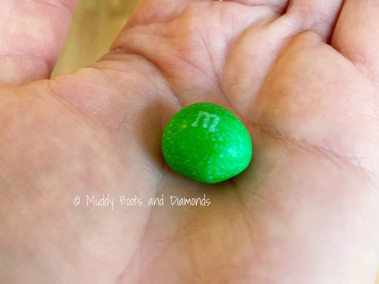 Green Peanut M&M in Palm of Hand via Muddybootsanddiamonds.com