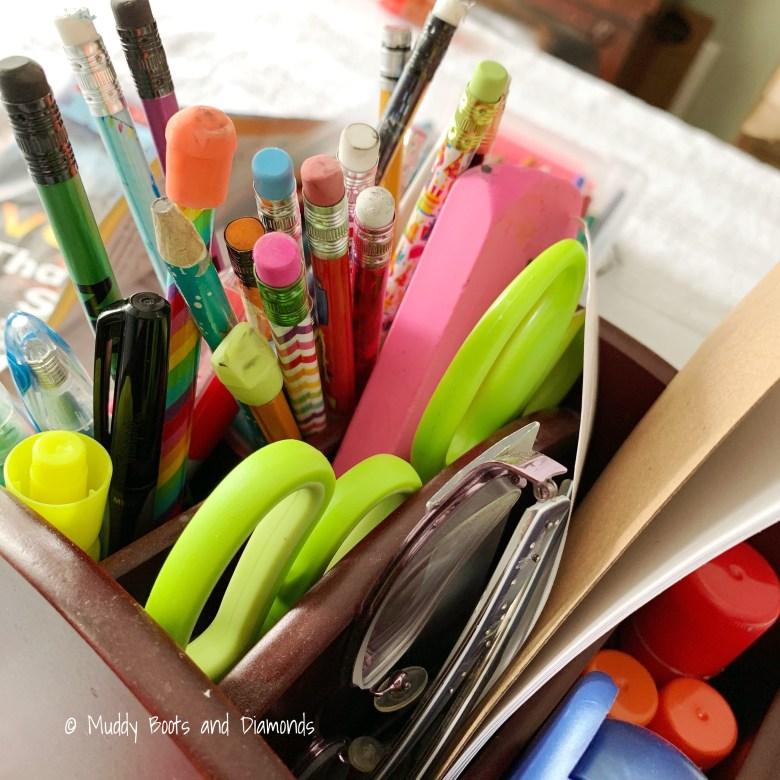 close up of pencil holder with pencils, pens, green scissors via muddybootsanddiamonds.com