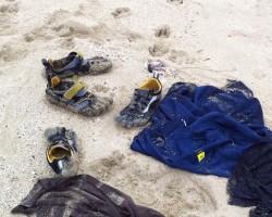 Shoes & Shirts Strewn on the Beach