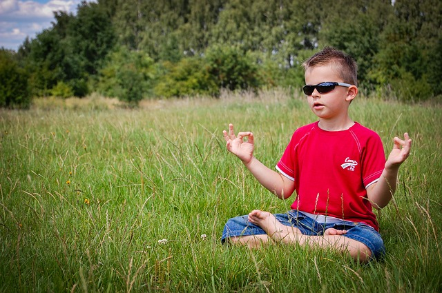Boy Meditating in Field