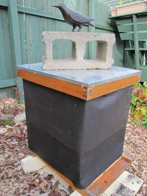 A hive wrapped in roofing felt.