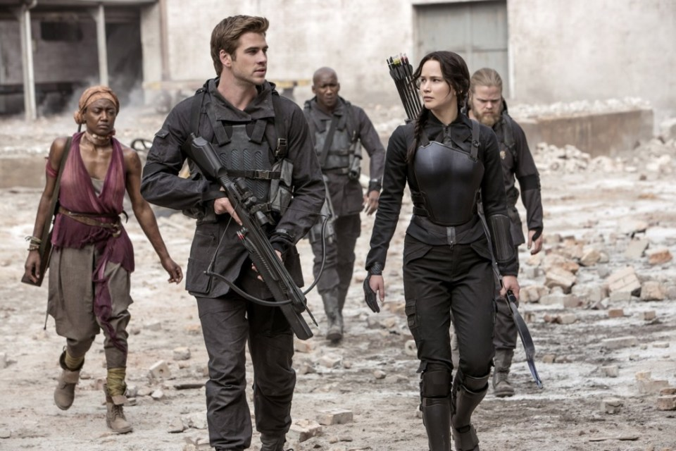 THE HUNGER GAMES: MOCKINGJAY - PART 1, from left: Patina Miller, Liam Hemsworth, Mahershala Ali,