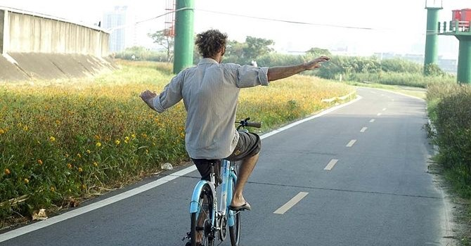 Campus Baffled at Student's Ability to Ride Bike without Using Handlebars
