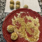 crushed pistachios and white chocolate chips for no bake protein bites coating
