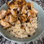 grilled chicken on top of mug pasta