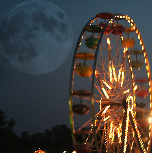 ferris wheel with large moon