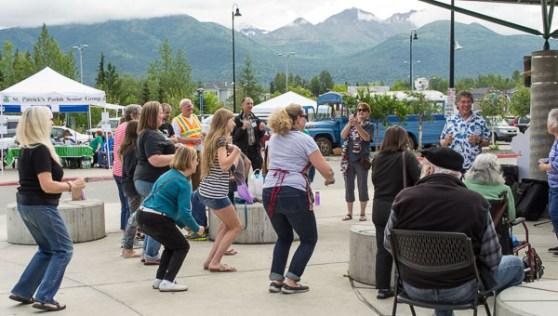 "Happy shoppers (& happy volunteers) joined in ""The Chicken Dance."""