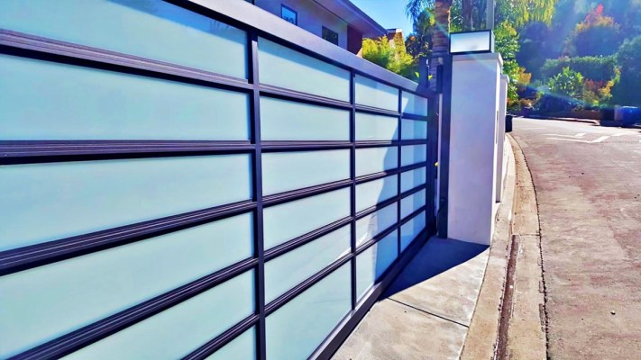 Black aluminum and blue glass driveway gate