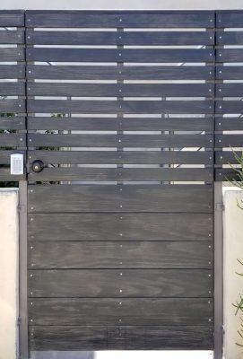 Horizontal slated wood entry gate