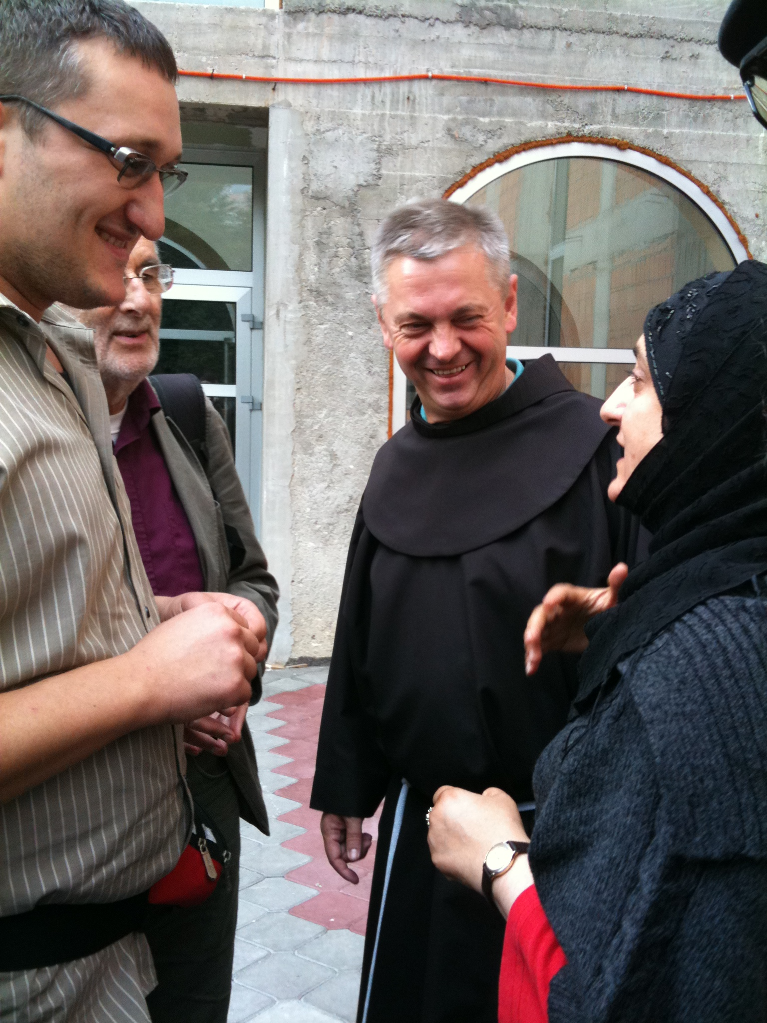 Fr Paulo, Paul from SANA (partially hidden), a Franciscan friar involved in the trauma centre based in Sarajevo (open to Bosnians from all communities) & Anjum.