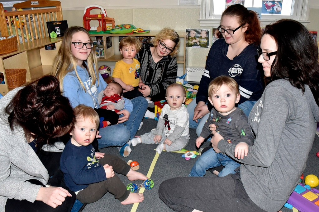 Teen mothers play with their children during a break in classes at the Sharon Abrams Teen Parent program at the Maine Children's Home for Little Wanderers in Waterville  Monday. The program receives funding through the United Way of Mid-Maine.