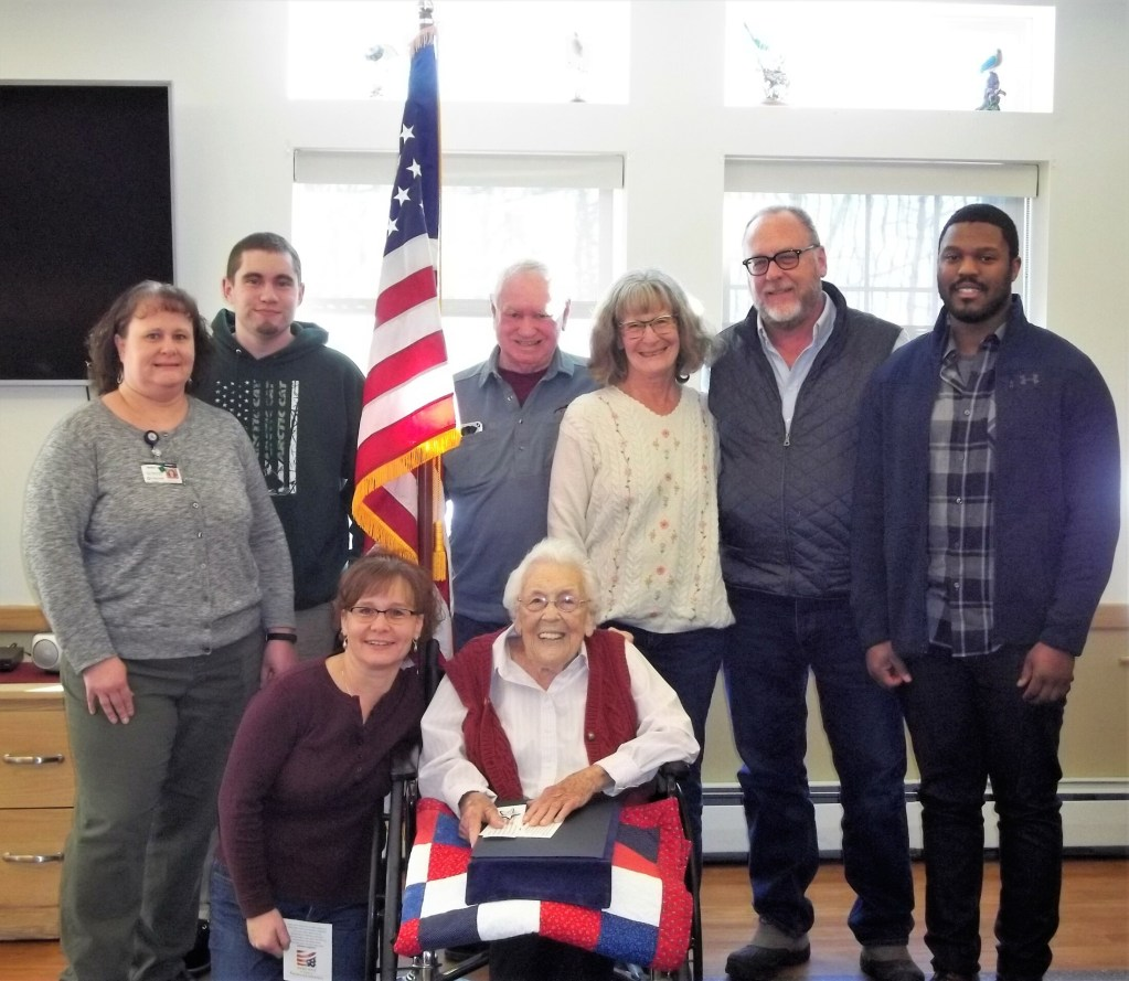 Several family members attended the ceremony for Jean Smith at Lakewood. Front from left are Jody Shields and Jean Smith. Back from left are Mandy Ledger, Jacob Ledger, Doug Farrin, Katie Farrin, Steve Smith and Chris Smith. Jean's granddaughter Mandy works in the business office at Lakewood.