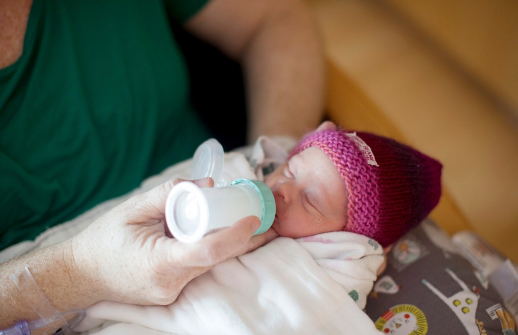 Melanie Lord feeds her newborn daughter, Lila, pasteurized breastmilk at Maine Medical Center on March 20. The hospital now gives pasteurized breastmilk from donors to some babies in their first four days of life. The milk comes from the Mothers' Milk Bank Northeast, a Massachusetts-based nonprofit that accepts donated milk and distributes it to hospitals.