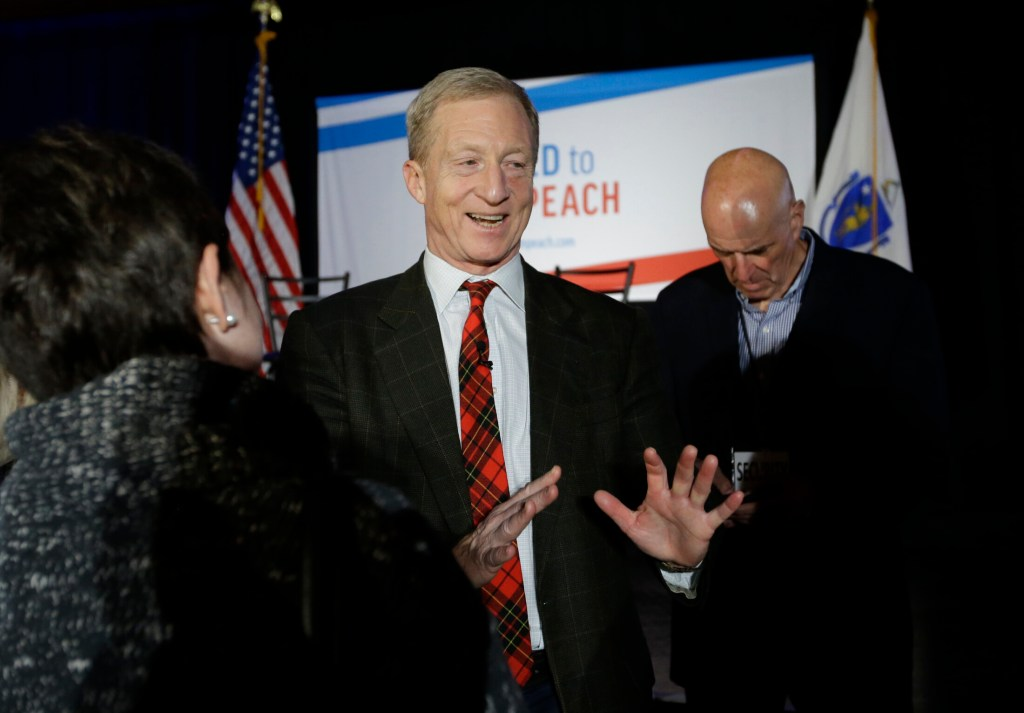 """Billionaire investor and Democratic activist Tom Steyer, center, greets people in the audience at the conclusion of a """"Need to Impeach"""" town hall event on March 13 in Agawam, Mass. Steyer claims that President Trump meets the criteria for impeachment. He is expected to announce his candidacy for president, according to reports."""