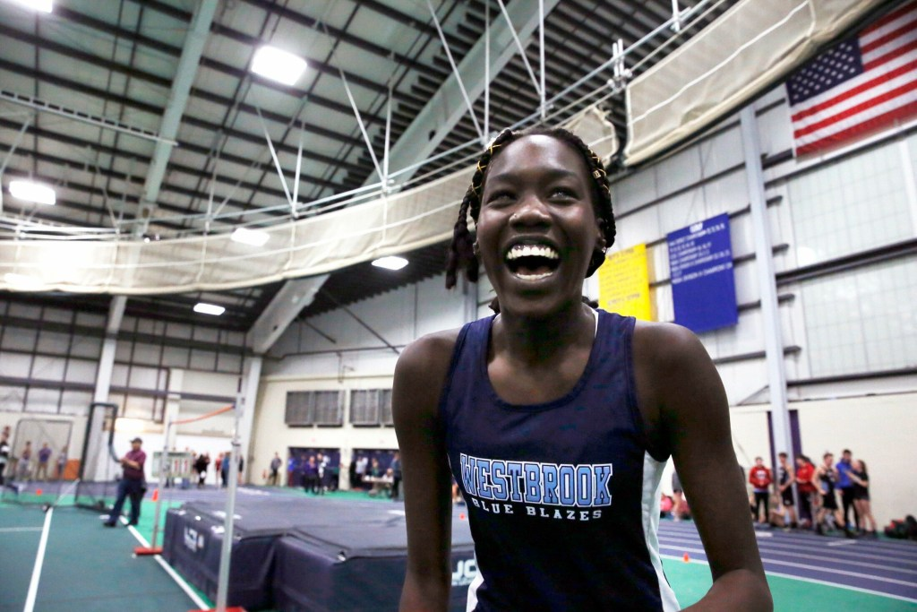 "GORHAM, ME - FEBRUARY 9: Westbrook's Nyagoa Bayak smiles after clearing 5'11"" during the senior division high jump on Saturday during the SMAA indoor track championships."